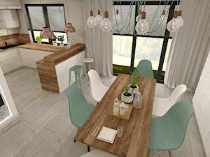 Aranżacja kuchni i salonu w domu jednorodzinnym - Średnia otwarta beżowa jadalnia w kuchni, styl nowoczesny - zdjęcie od Atelier Art&Design