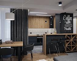 Mieszkanie 53m2 Bemowo - Średnia otwarta szara czarna kuchnia dwurzędowa w aneksie z oknem, styl nowoczesny - zdjęcie od DEDEKO