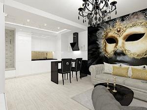 projekt mieszkania w czerni i złocie