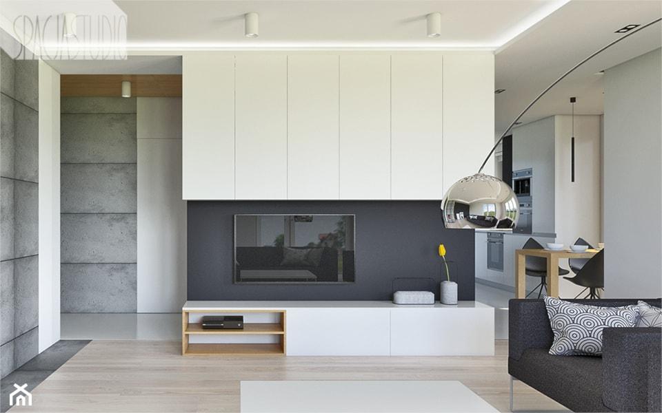 dom w Toruniu - Średni szary biały salon z kuchnią z jadalnią, styl minimalistyczny - zdjęcie od Spacja Studio - Homebook