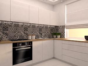 projekt aranżacji mieszkania we Wrocławiu - Biała kuchnia w kształcie litery l, styl skandynawski - zdjęcie od Dekoncept