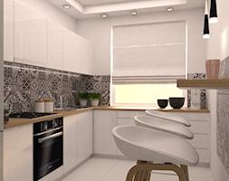 projekt aranżacji mieszkania we Wrocławiu - Średnia wąska biała kolorowa kuchnia w kształcie litery l, styl skandynawski - zdjęcie od Dekoncept