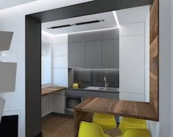 projekt kawalerski w Krakowie - Mała średnia otwarta biała kuchnia w kształcie litery l z oknem, styl nowoczesny - zdjęcie od Dekoncept