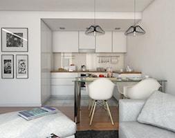 betonowy chaos - Średnia otwarta biała beżowa kuchnia w kształcie litery l w aneksie, styl skandynawski - zdjęcie od Dekoncept