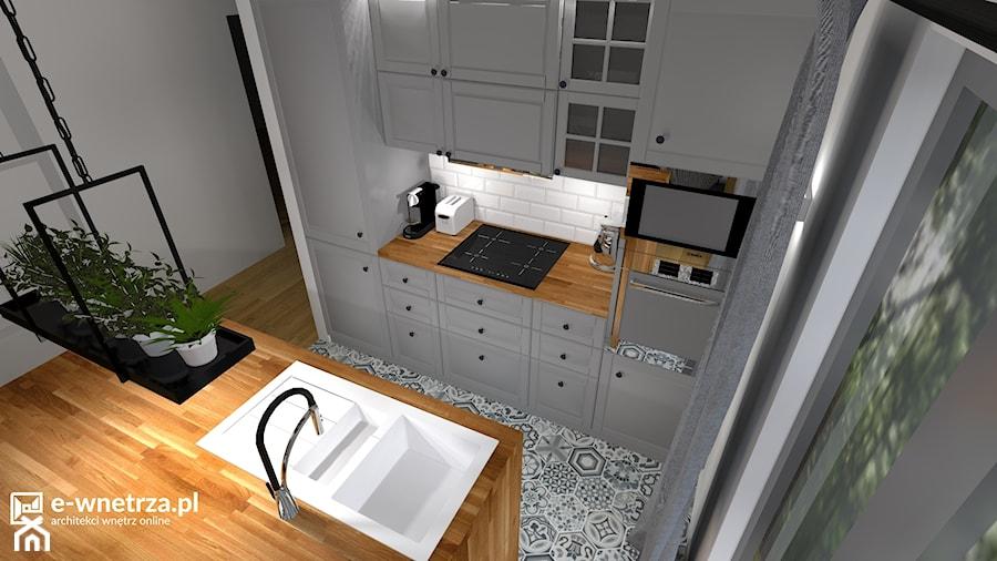 Kuchnia - nowoczesna czy klasyczna? - Mała zamknięta wąska biała kuchnia dwurzędowa w aneksie z oknem, styl klasyczny - zdjęcie od e-wnetrza.pl