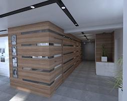 DOM parterowy - Duży brązowy szary hol / przedpokój, styl nowoczesny - zdjęcie od Interior Design A3D Architekci Krzysztof Gruszfeld