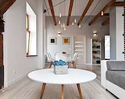 K12 Apartament 1 - Kraków - Realizacja 2015 - Duża otwarta szara jadalnia w salonie, styl skandynawski - zdjęcie od NOVI art Pracownia projektowa