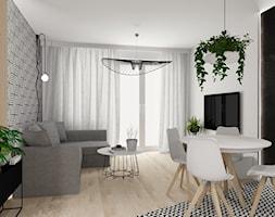 Mieszkanie we Wrocławiu - Mały szary czarny salon z jadalnią, styl nowoczesny - zdjęcie od KP Pure Form