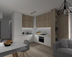 Projekt Mieszkania dla studentów - Średnia otwarta szara jadalnia w salonie, styl skandynawski - zdjęcie od KP Pure Form