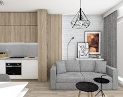 Projekt Mieszkania dla studentów - Mały biały salon z kuchnią z jadalnią, styl skandynawski - zdjęcie od KP Pure Form