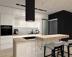 Dom 118m2 Iwiny- kuchnia - Średnia otwarta szara czarna kuchnia dwurzędowa z wyspą, styl nowoczesny - zdjęcie od KROPKA Design