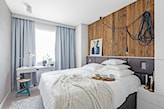 sypialnia z dużym łóżkiem