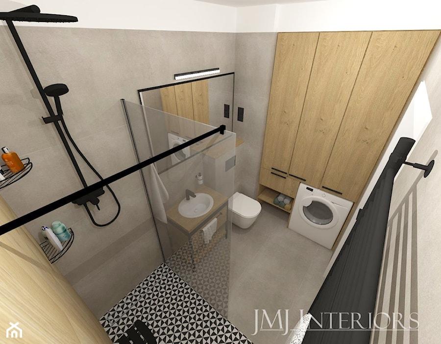 Komfortowe mieszkanie dla młodego małżeństwa - Gdańsk - Mała szara łazienka w bloku w domu jednorodzinnym bez okna - zdjęcie od JMJ Interiors