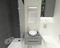 MIeszkanie w Gdańskim Alfa Parku - Mała biała czarna łazienka na poddaszu w bloku w domu jednorodzin ... - zdjęcie od JMJ Interiors - Homebook
