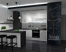 Projekt mieszkania w Zielonej Górze - Mała otwarta biała czarna kuchnia w kształcie litery l w aneksie z wyspą, styl nowoczesny - zdjęcie od K&K Pracownia Projektowania Wnętrz