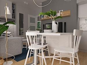 Polna-Północ - Mała otwarta szara jadalnia w kuchni w salonie, styl skandynawski - zdjęcie od MOTIF DESIGN