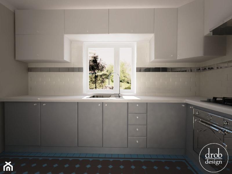 Biało szara kuchnia z kamionkową podłogą  zdjęcie od Drob