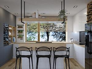 Dom w Kętrzynie - Średnia otwarta biała kuchnia w kształcie litery u z wyspą z oknem, styl nowoczesny - zdjęcie od Architekt Wnętrz Patrycja Wojtaś