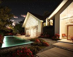Średni ogród za domem z basenem, styl nowoczesny - zdjęcie od artMOKO