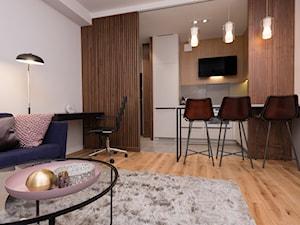 Widok z salonu na aneks kuchenny - zdjęcie od Viva Design Pracownia Projektowania Wnętrz