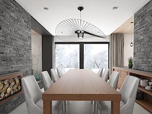 Wnętrze domu w Budach Grabskich - Duża zamknięta beżowa jadalnia jako osobne pomieszczenie, styl nowoczesny - zdjęcie od Tu architekci