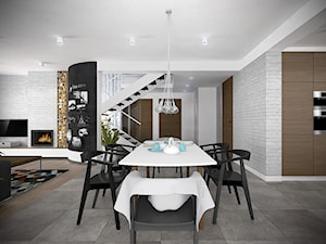 Wnętrze domu w Starowej Górze - Średnia otwarta biała czarna jadalnia w kuchni w salonie, styl skandynawski - zdjęcie od Tu architekci