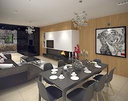 Wnętrze domu jednorodzinnego w Łodzi - Duży biały brązowy salon z jadalnią, styl nowoczesny - zdjęcie od Tu architekci