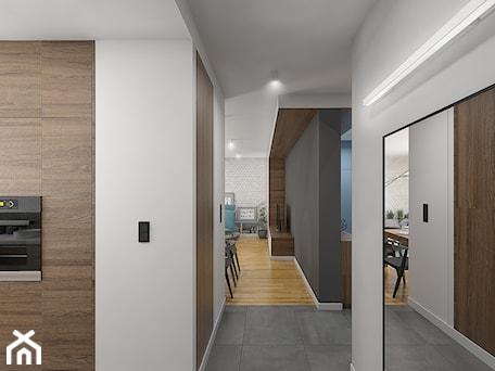 Aranżacje wnętrz - Hol / Przedpokój: Wnętrze mieszkania na Teofilowie - Średni biały szary hol / przedpokój, styl skandynawski - Tu architekci. Przeglądaj, dodawaj i zapisuj najlepsze zdjęcia, pomysły i inspiracje designerskie. W bazie mamy już prawie milion fotografii!