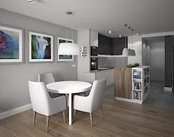 Wnętrze mieszkania na Radogoszczu - Średnia otwarta szara jadalnia w kuchni w salonie, styl nowoczesny - zdjęcie od Tu architekci