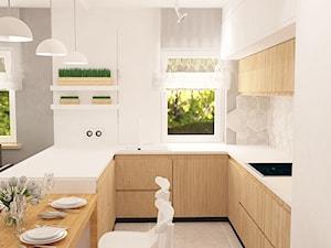 """Mieszkanie na Suwalskiej - Średnia otwarta wąska biała szara kuchnia w kształcie litery u z wyspą z oknem, styl skandynawski - zdjęcie od Pracownia Projektowa """"Interior-Art"""""""