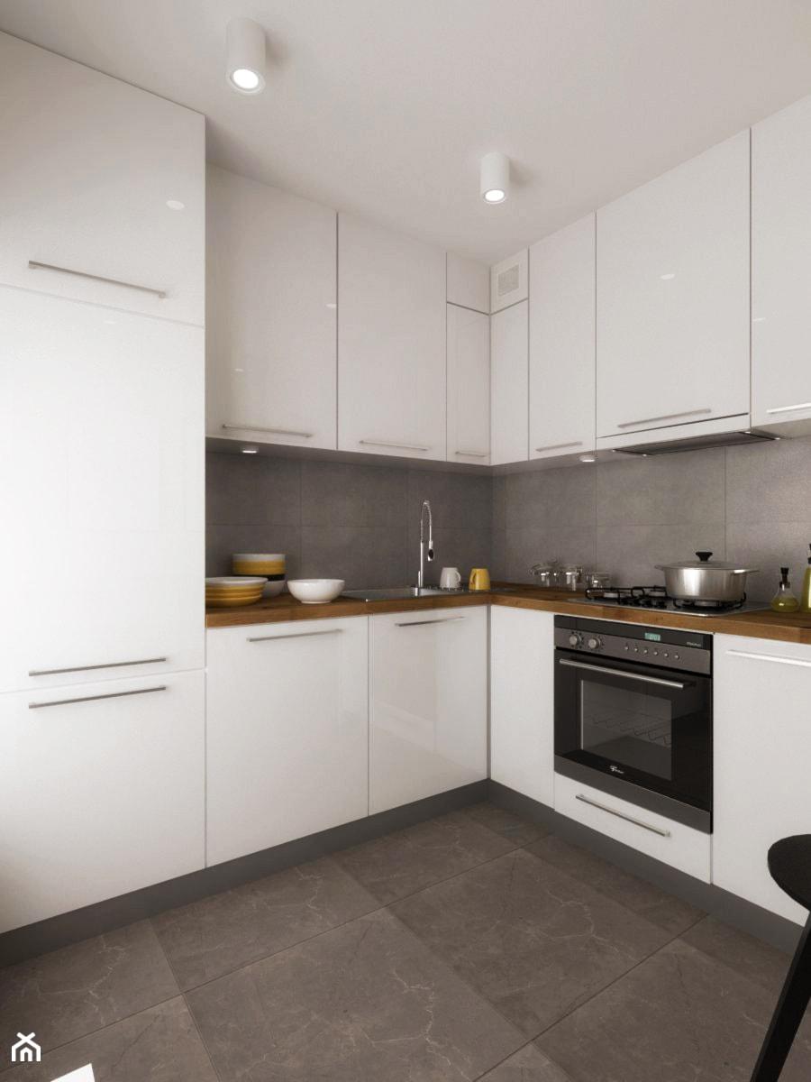 Biała kuchnia  Średnia kuchnia w kształcie litery l, styl   -> Biala Kuchnia Uchwyty Frezowane