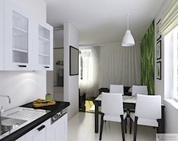 Mieszkanie 55m2 Oświęcim - Mała otwarta biała zielona jadalnia w kuchni, styl kolonialny - zdjęcie od KJ Studio