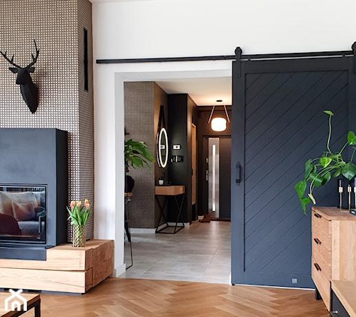 Salon z drzwiami przesuwnymi – 7 inspirujących pomysłów na aranżację wnętrza
