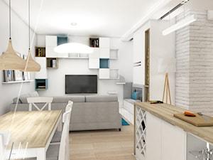 Ala ma kota... - Mały biały salon z barkiem z kuchnią z jadalnią, styl nowoczesny - zdjęcie od AAW studio