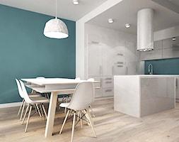 projekt wnętrz mieszkania Oborniki Śląskie - Duża otwarta biała turkusowa jadalnia w kuchni w salonie, styl minimalistyczny - zdjęcie od archi.GO! pracownia projektowa