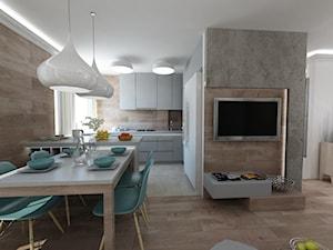 Średnia otwarta szara jadalnia w kuchni w salonie, styl skandynawski - zdjęcie od MooNooDesign