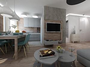 Duża otwarta szara jadalnia w kuchni w salonie, styl skandynawski - zdjęcie od MooNooDesign