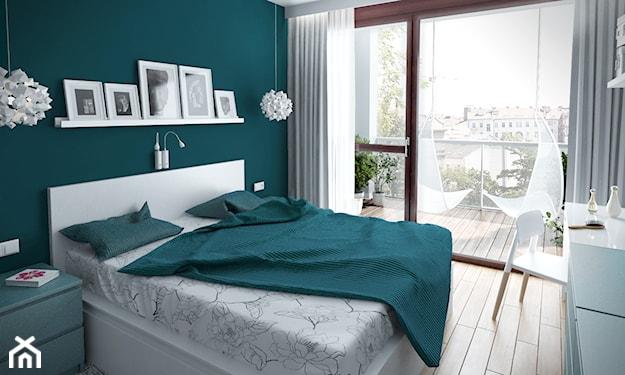 ściany w kolorze morskim i białe meble w sypialni