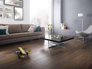 Jak urządzić przytulny salon? Możesz wykorzystać płytki drewnopodobne. Zobacz efekt!