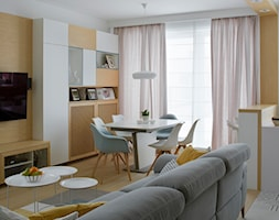 Wilanów - 100m2 REALIZACJA - Średnia otwarta biała jadalnia w salonie, styl skandynawski - zdjęcie od TutajConcept
