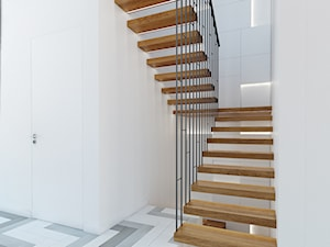 Podkowa Leśna - Średnie wąskie schody dwubiegowe drewniane metalowe, styl nowoczesny - zdjęcie od TutajConcept