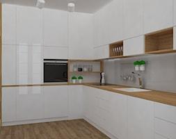 Mieszkanie w ciepłym skandynawskim stylu - Duża otwarta kuchnia w kształcie litery l w aneksie, styl skandynawski - zdjęcie od Design Factory Studio Projektowe - Homebook