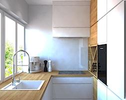 Trzy pokoje na Teofilowie - Mała zamknięta wąska biała kuchnia w kształcie litery u z oknem, styl skandynawski - zdjęcie od Design Factory Studio Projektowe