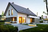 biały dom ze spadzistym dachem i z werandą