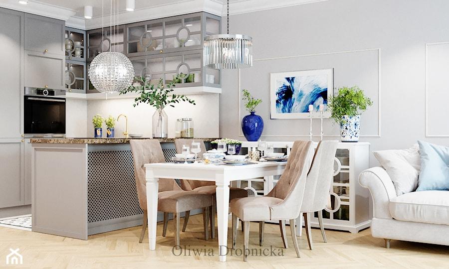 Klasyczna elegancja w nowoczesnym wydaniu - Mała biała szara kuchnia w kształcie litery u w aneksie z wyspą, styl klasyczny - zdjęcie od Projektowanie Wnętrz Oliwia Drobnicka
