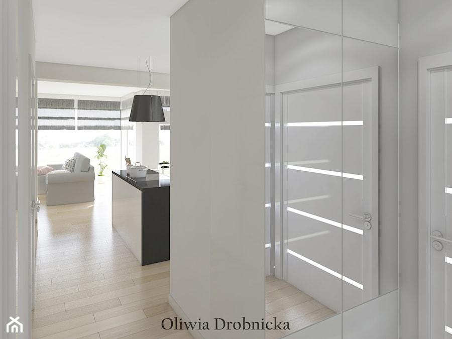 Projekt domu w Katowicach - Mały biały salon - zdjęcie od Projektowanie Wnętrz Oliwia Drobnicka