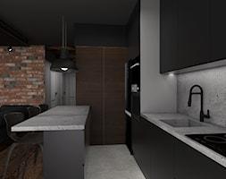 Mieszkanie inspirowane stylem industrialnym - Duża otwarta szara kuchnia w kształcie litery u w aneksie, styl industrialny - zdjęcie od Archikąty - Homebook