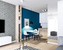 Mieszkanie pod wynajem 2 - Mała otwarta biała niebieska jadalnia w kuchni w salonie, styl nowoczesny - zdjęcie od Żaneta Strażyńska