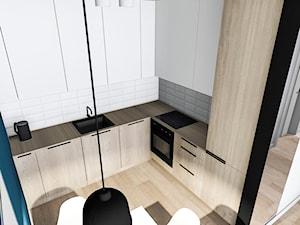 Mieszkanie pod wynajem 2 - Średnia zamknięta czarna niebieska kuchnia w kształcie litery l w aneksie, styl nowoczesny - zdjęcie od Żaneta Strażyńska