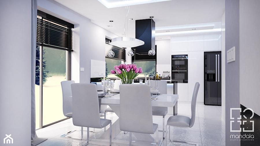 Projekt nowoczesnego wnętrza w domu jednorodzinnym - Średnia otwarta szara jadalnia w kuchni, styl nowoczesny - zdjęcie od studio_projektowe_mandala